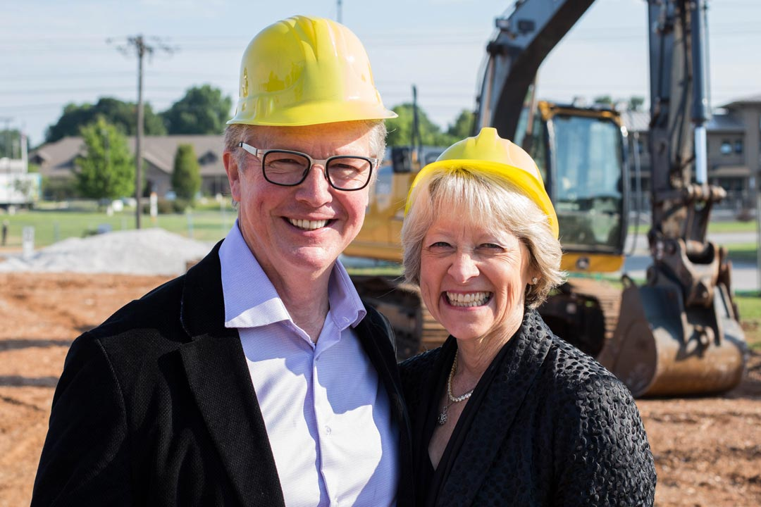 Rick and Jane McElvaine breaking ground at Maxon's current location.