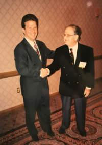 Rick McElvaine and Joe Maxon shaking hands.